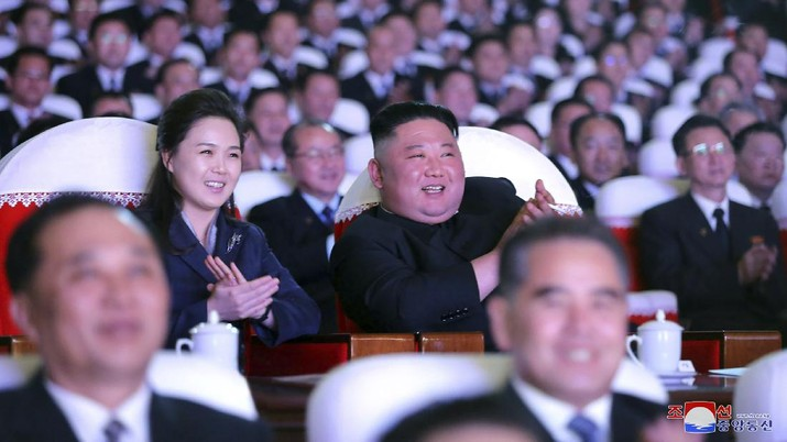 In this photo provided by the North Korean government, North Korean leader Kim Jong Un, center, and his wife Ri Sol Ju watch a performance marking the birth anniversary of former leader Kim Jong Il, in Pyongyang, North Korea, Tuesday, Feb. 16, 2021. Ri has reappeared in North Korea's state media for the first time in just over year. Independent journalists were not given access to cover the event depicted in this image distributed by the North Korean government. The content of this image is as provided and cannot be independently verified. Korean language watermark on image as provided by source reads: