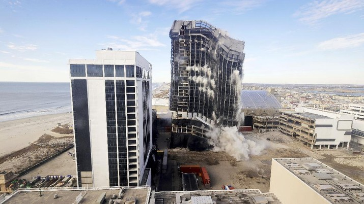 The former Trump Plaza Hotel & Casino implodes in Atlantic City, N.J., Wednesday, Feb 17, 2021. The former Trump Plaza casino was imploded after falling into such disrepair that chunks of the building began peeling off and crashing to the ground. (Edward Lea/The Press of Atlantic City via AP)
