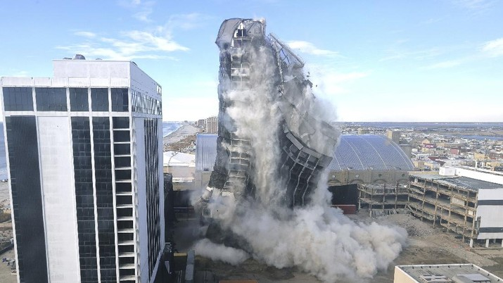The former Trump Plaza Hotel & Casino implodes in Atlantic City, N.J., Wednesday, Feb 17, 2021.The former Trump Plaza casino was imploded after falling into such disrepair that chunks of the building began peeling off and crashing to the ground.  (Edward Lea/The Press of Atlantic City via AP)