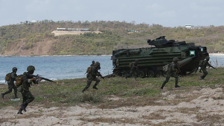 Thai soldiers take their position in front of an amphibious assault vehicle after landing during the ongoing Cobra Gold U.S.-Thai joint military exercise on Hat Yao beach in Chonburi province, eastern Thailand, Saturday, Feb. 16, 2019. Cobra Gold military exercise is the biggest activity of its type in the Asia-Pacific region with 29 nations taking part as participants or observers. (AP Photo/Sakchai Lalit)