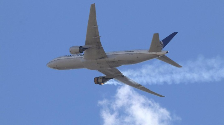 This Saturday, Feb. 20, 2021 photo provided by Hayden Smith shows United Airlines Flight 328 approaching Denver International Airport, after experiencing