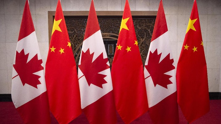 This Dec. 5, 2017, photo shows flags of Canada and China prior to a meeting of Canadian Prime Minister Justin Trudeau and Chinese President Xi Jinping at the Diaoyutai State Guesthouse in Beijing. (Fred Dufour/Pool Photo via AP)