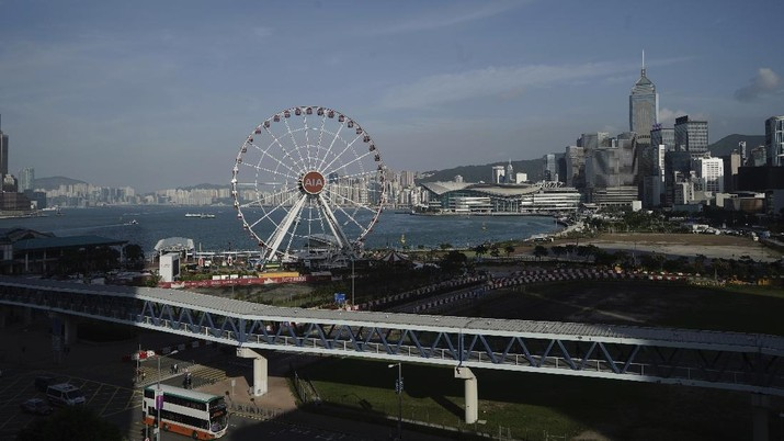 The Hong Kong Observation Wheel is seen at waterfront in Hong Kong, Thursday, Oct. 15, 2020. Hong Kong and Singapore say they have agreed to a bilateral air travel bubble, re-establishing travel links as coronavirus infections in both cities decline. (AP Photo/Kin Cheung)