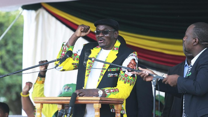 Zimbabwean deputy president Kembo Mohadi addresses the crowd, at a rally in Mount Darwin about 200 Kilometres north of Harare, Saturday, Feb, 2, 2019. A spokesman says Zimbabwe's president has skipped his first political rally since last month's deadly military crackdown on protests so he could explain the unrest to fellow African leaders. President Emmerson Mnangagwa's administration has been under pressure amid reports of at least 12 people killed, hundreds wounded and some women raped.  (AP Photo/Tsvangirayi Mukwazhi)