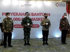 Perangi Covid-19, Pemerintah Serahkan Bantuan 35 Juta Masker