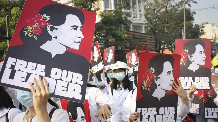Medicals students display images of deposed Myanmar leader Aung San Suu Kyi during a street march in Yangon, Myanmar, Sunday, Feb. 28, 2021. Police in Myanmar escalated their crackdown on demonstrators against this month's military takeover, deploying early and in force on Saturday as protesters sought to assemble in the country's two biggest cities and elsewhere. (AP Photo)