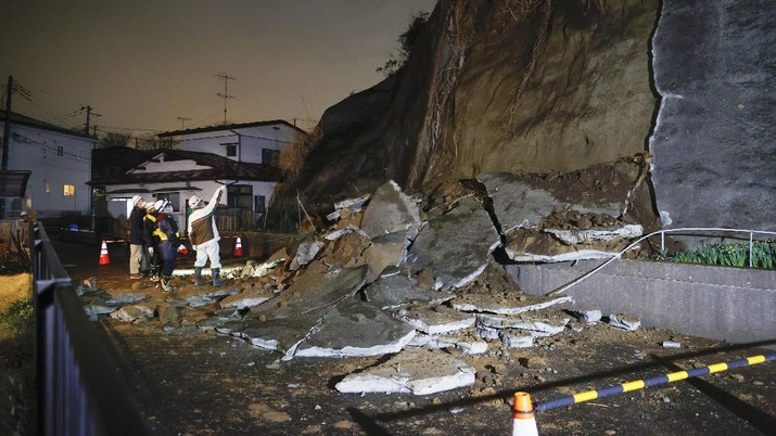 A collapsed section of a cliff is seen in Shiogama, Miyagi Prefecture, northern Japan Saturday March 20, 2021, after a powerful earthquake struck northeastern Japan. A strong earthquake struck Saturday off northern Japan, shaking buildings even in Tokyo and triggering a tsunami advisory for a part of the northern coast. (Kyodo News via AP)