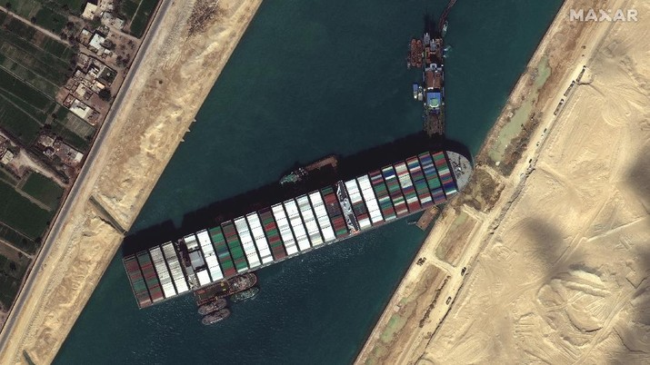 This satellite image from Maxar Technologies shows the cargo ship MV Ever Given stuck in the Suez Canal near Suez, Egypt, Saturday, March 27, 2021.   Authorities are preparing to make new attempts to free the giant container vessel stuck in Egypt's Suez Canal for a fifth day and reopen a crucial east-west waterway for global shipping.   (©Maxar Technologies via AP)