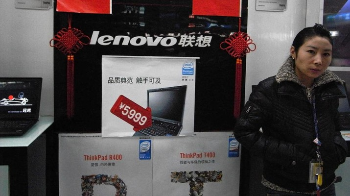 FILE - In this Jan. 8, 2009 file photo, a vendor waits for customers at a computer shop selling Lenovo laptops in Beijing, China. Chinese personal computer maker Lenovo said Thursday Feb. 17, 2011, its quarterly profit rose 25 percent on double-digit sales growth in developing markets. (AP Photo/Ng Han Guan, File)