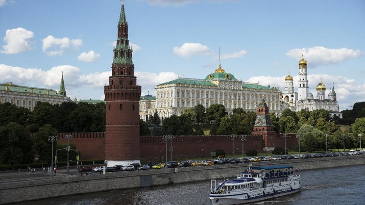 A tourist boat passes the Kremlin in Moscow, Russia, Friday, July 10, 2020, with the Grand Kremlin Palace, center, the Ivan the Great Bell Tower, center right, and Vodovzvodnaya Tower, center left in the background. The first Russian monument to become part of UNESCO world heritage 30 years ago, Moscow's Kremlin Museums struggle to finance restoration works amid coronavirus outbreak and move freeze most of the projects until the next year. Previously the most visited sight in Russia's capital, with almost 3 million visitors in 2019, Kremlin Museums have seen almost ten-fold decrease of tourists. (AP Photo/Pavel Golovkin)