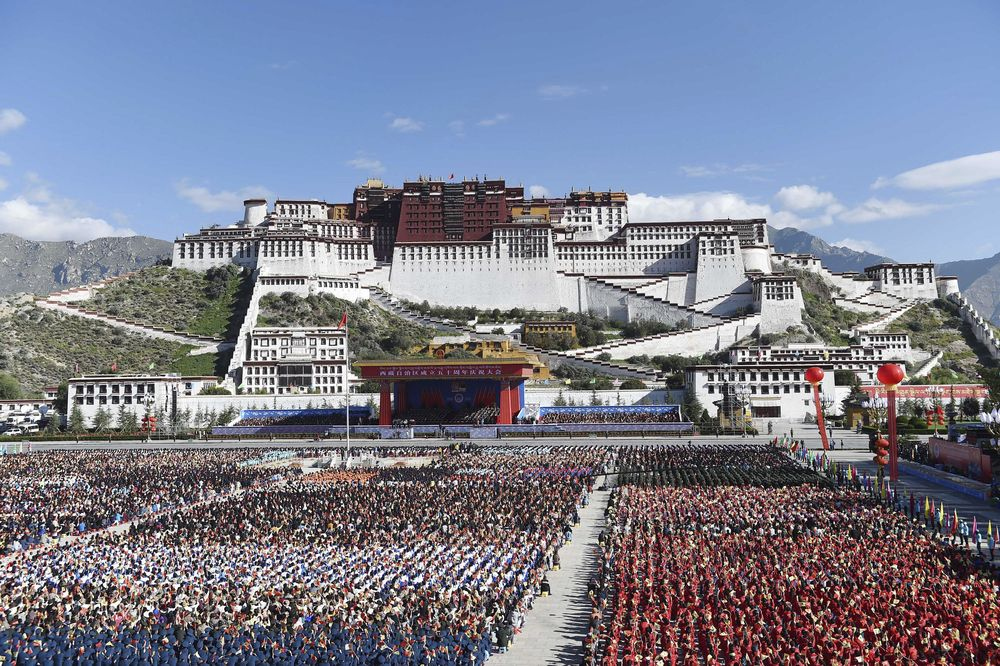 In this photo released by China's Xinhua News Agency, a grand ceremony marking the 50th anniversary of the founding of the Tibet Autonomous Region is held at the square of the Potala Palace in Lhasa, capital of southwest China's Tibet Autonomous Region, Tuesday, Sept. 8, 2015. (Chen Yehua/Xinhua via AP) NO SALES