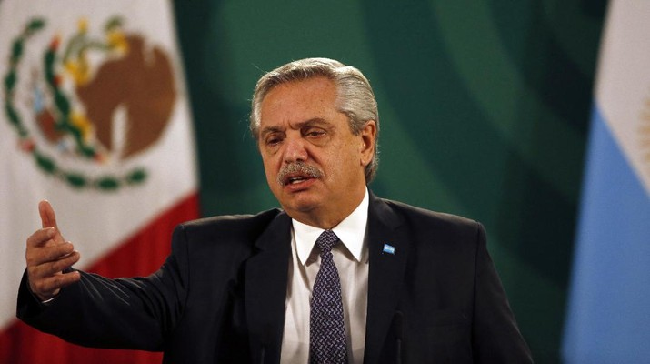 FILE - In this Feb. 23, 2021 file photo, Argentina's President Alberto Fernandez speaks during Mexican President Andrés Manuel Lopez Obrador's daily, morning news conference at the National Palace in Mexico City.   Fernandez says he had an initial positive test for COVID-19, despite having been vaccinated in January. Fernandez sent a tweet late Friday, April 2,  saying took a quick antigen test for the virus after feeling a headache and experiencing a fever of 37.3 Celsius (99.1 Fahrenheit). (AP Photo/Marco Ugarte, File)