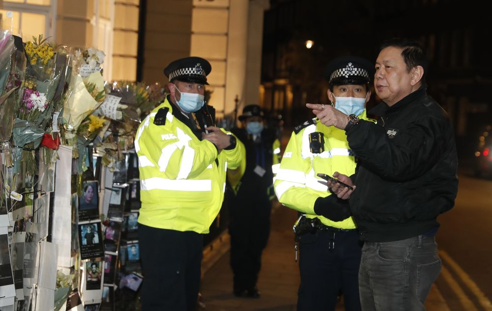 Kyaw Zwar Minn, right, the Myanmar ambassador, talks to police outside the Myanmar Embassy in London, Wednesday, April 7, 2021. Newspaper reports say the embassy was taken over by members of the country's new military regime Wednesday evening. (AP Photo/Alastair Grant)