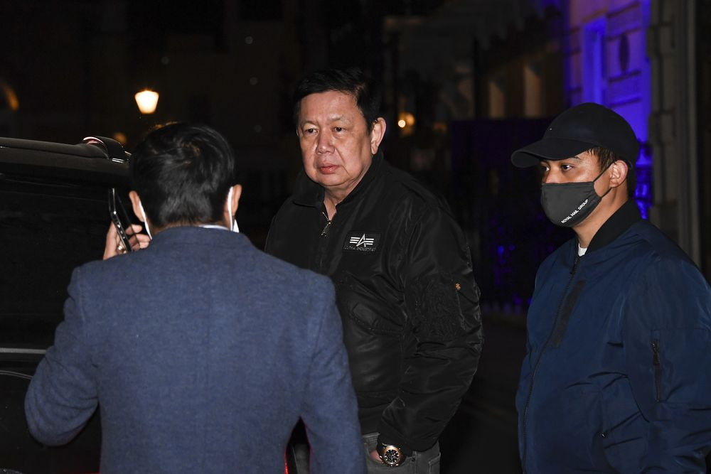 Kyaw Zwar Minn, center, the Myanmar ambassador, talks with his staff outside the Myanmar Embassy in London, Wednesday, April 7, 2021. Newspaper reports say the embassy was taken over by members of the country's new military regime Wednesday evening. (AP Photo/Alberto Pezzali)
