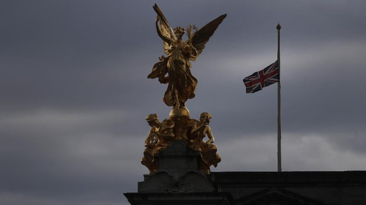 The Union flag flies at half mast over Buckingham Palace in London, Friday, April 9, 2021. Buckingham Palace officials say Prince Philip, the husband of Queen Elizabeth II, has died. He was 99. (AP Photo/Alastair Grant)