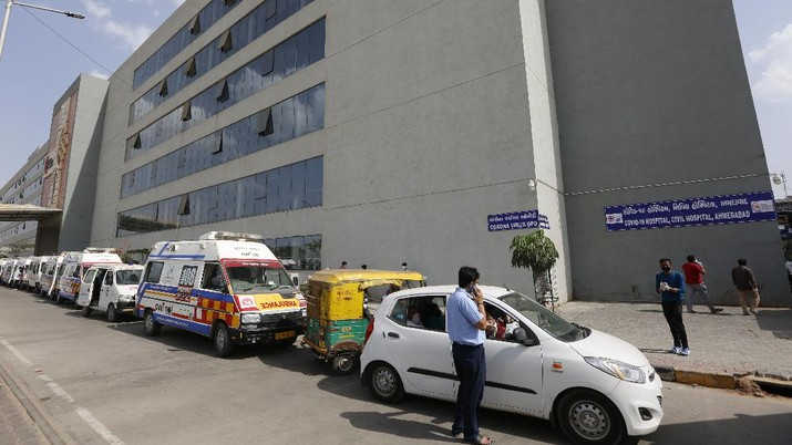 Ambulances carrying COVID-19 patients line up waiting for their turn to be attended at a dedicated COVID-19 government hospital in Ahmedabad, India, Saturday, April 17, 2021. The global death toll from the coronavirus topped a staggering 3 million people Saturday amid repeated setbacks in the worldwide vaccination campaign and a deepening crisis in places such as Brazil, India and France. (AP Photo/Ajit Solanki)