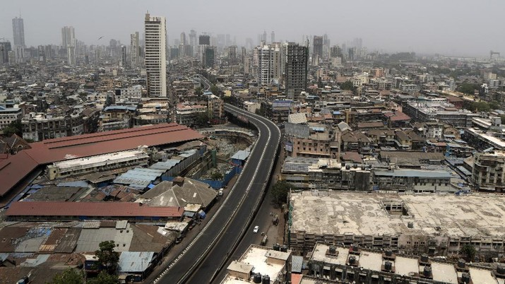 A street is seen deserted during weekend lockdown in Mumbai, India, Saturday, April 10, 2021. India has been overwhelmed by hundreds of thousands of new coronavirus cases daily, bringing pain, fear and agony to many lives as lockdowns have been placed in Delhi and other cities around the country. (AP Photo/Rajanish Kakade)