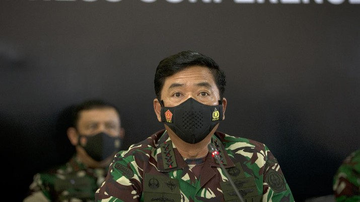 Indonesian Military chief Hadi Tjahjanto, right, talks to media during a press conference regarding its missing naval submarine in Bali, Indonesia on Thursday, April 22, 2021. Indonesia's navy ships are intensely searching the waters where one of its submarines was last detected before it disappeared, as neighboring countries are set to join the complex operation. (AP Photo/Firdia Lisnawati)