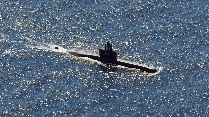In this aerial photo taken from a maritime patrol aircraft of 800 Air Squadron of the 2nd Air Wing of Naval Aviation Center (PUSPENERBAL), the Indonesian Navy submarine KRI Alugoro sails during a search for KRI Nanggala, another submarine that went missing while participating in a training exercise on Wednesday, in the waters off Bali Island, Indonesia, Thursday, April 22, 2021. Indonesia's navy ships on Thursday were intensely searching for the submarine that likely fell too deep to retrieve, making survival chances for all the crew on board slim. Authorities said oxygen in the submarine would run out by early Saturday. (AP Photo/Eric Ireng)