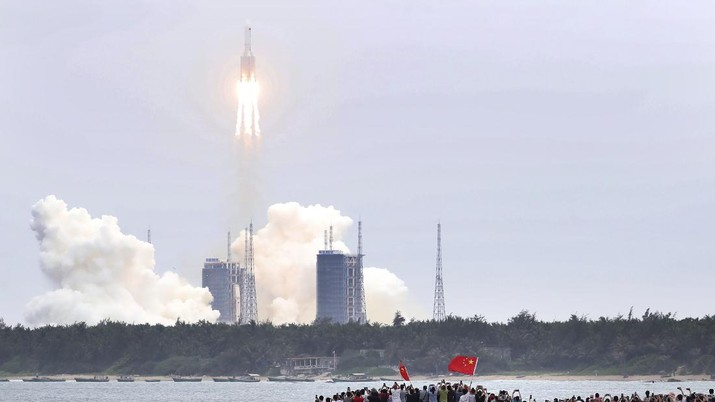 In this photo released by China's Xinhua News Agency, a Long March 5B rocket carrying a module for a Chinese space station lifts off from the Wenchang Spacecraft Launch Site in Wenchang in southern China's Hainan Province, Thursday, April 29, 2021. China has launched the core module on Thursday for its first permanent space station that will host astronauts long-term. (Jin Liwang/Xinhua via AP)