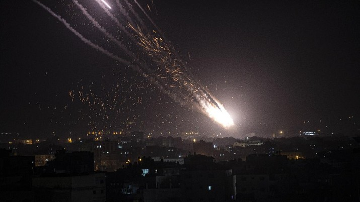 Rockets are launched from the Gaza Strip towards Israel, Monday, May. 10, 2021. Hamas militants fired dozens of rockets into Israel on Monday, including a barrage that set off air raid sirens as far away as Jerusalem, after hundreds of Palestinians were hurt in clashes with Israeli police at a flashpoint religious site in the contested holy city. (AP Photo/Khalil Hamra)