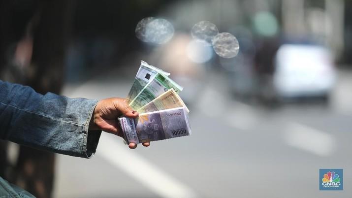Jelang Lebaran, Penukaran Uang Pecahan  Rupiah Kecil Baru Mulai Ramai (CNBC Indonesia/Tri Susilo)