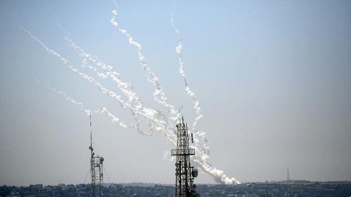 Rockets are launched from Gaza Strip to Israel, Thursday, May 13, 2021. Israeli airstrikes killed multiple senior Hamas military figures Wednesday and toppled a pair of high-rise towers housing Hamas facilities. (AP Photo/Hatem Moussa)
