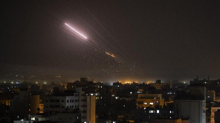 Rockets are launched from Gaza Strip to Israel, early Friday, May 14, 2021. (AP Photo/Khalil Hamra)