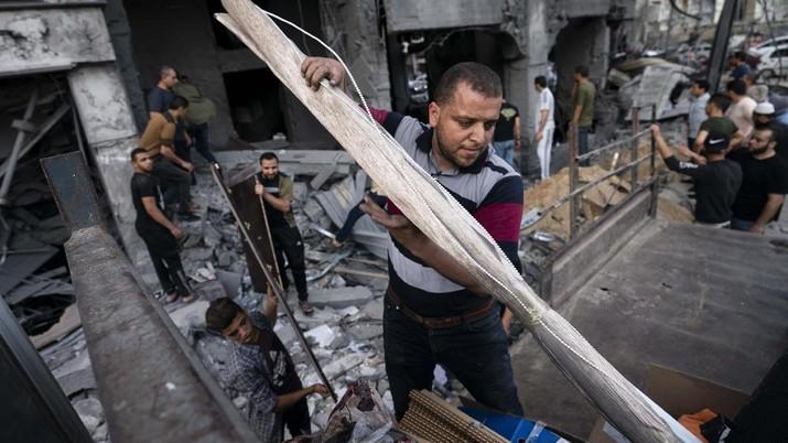 Kesepakatan gencatan senjata mengakhiri aksi saling serang anåtara Israel dan Palestina di jalur Gaza. (AP/John Minchillo)