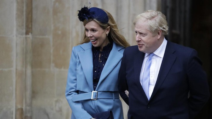 Britain's Prime Minister Boris Johnson and his partner Carrie Symonds leave after attending the annual Commonwealth Day service at Westminster Abbey in London, Monday, March 9, 2020. The annual service, organised by the Royal Commonwealth Society, is the largest annual inter-faith gathering in the United Kingdom. (AP Photo/Kirsty Wigglesworth)