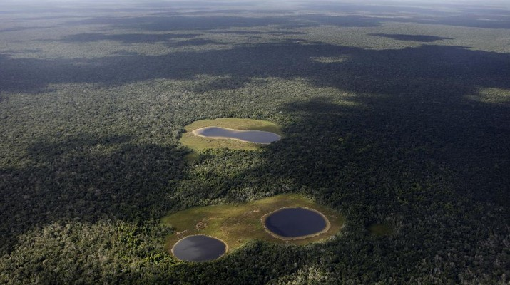 An aerial view of some freshwater filled sinkholes, known in Spanish as 'cenotes', in the Yucatan peninsula, Mexico, Tuesday, Nov. 30, 2010. During the annual UN Climate Change Conference which is being held in Cancun, Mexico, the World Meteorological Organization said Tuesday the heat waves that killed thousands of people in Europe in 2003 and that choked Russia earlier this year, will appear like an average summer in the future as the Earth continues to warm. (AP Photo/Eduardo Verdugo)