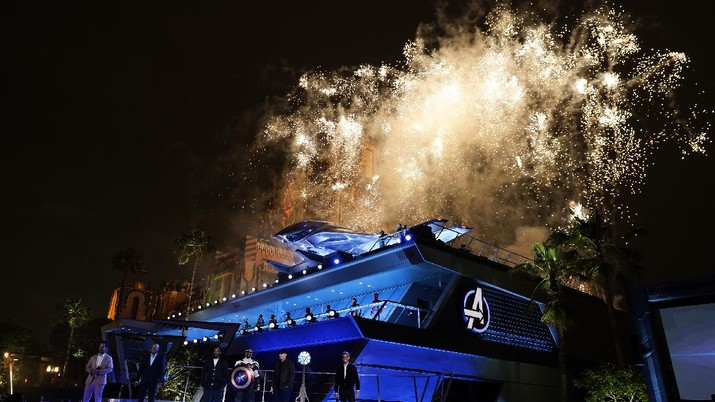 A fireworks display is presented as Paul Rudd, from left, Disney CEO Bob Chapek, Anthony Mackie, a Captain America character, Marvel President Kevin Feige and Josh D'Amaro, chairman, Disney parks, experiences and products appear on stage at the Avengers Campus dedication ceremony at Disney's California Adventure Park on Wednesday, June 2, 2021, in Anaheim, Calif. (AP Photo/Chris Pizzello)