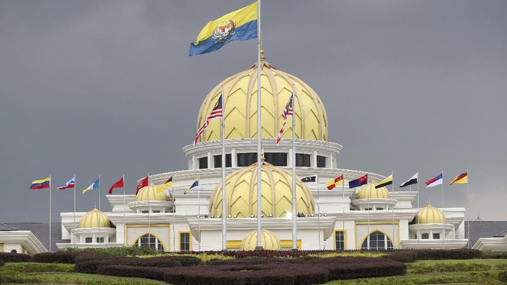Flags fly at the Malaysia National Palace in Kuala Lumpur, Malaysia, Thursday, Jan. 24, 2019. King Sultan Muhammad V shocked the nation by announcing his abdication in January 2019, days after returning from two months of medical leave. The 49-year-old sultan from eastern Kelantan state only reigned for two years as Malaysia's 15th king and didn't give any reason for quitting. Sultan Abdullah Azlan Shah succeeded his ailing 88-year-old father on Jan. 15, in a move seen as paving the way for him to become the next king. (AP Photo/Vincent Thian)