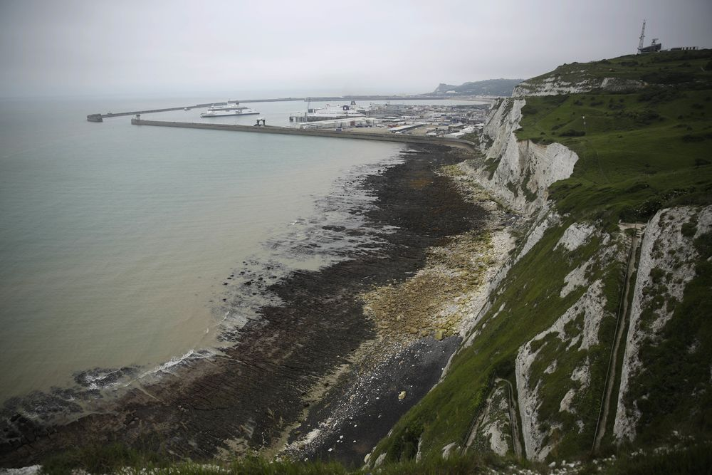 Ferries come and go from the Port of Dover, in Dover, south east England, Thursday, June 9, 2016. On a clear day, the coast of France is visible from Dovers famous white cliffs, and they provided a vital vantage point for the early spotting of German bombers heading toward London during World War II. (AP Photo/Matt Dunham)