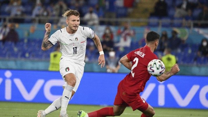 Italy's Ciro Immobile scores his side's second goal during the Euro 2020, soccer championship group A match between Italy and Turkey, at the Rome Olympic stadium, Friday, June 11, 2021. (Alfredo Falcone/LaPresse via AP)