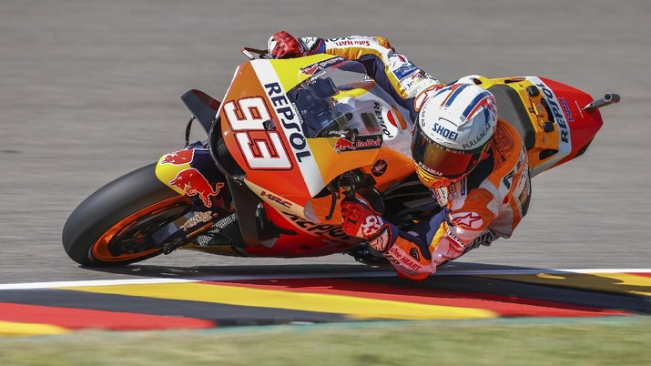 Spain's Marc Marquez of Repsol Honda Team, speeds at a free training session of the MotoGP in Hohenstein-Ernstthal, Germany, Friday, June 18, 2021. (Jan Woitas/dpa via AP)