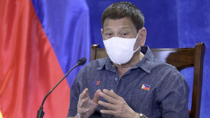 CORRECTS CITY TO DAVAO INSTEAD OF MANILA - In this photo provided by the Malacanang Presidential Photographers Division, Philippine President Rodrigo Duterte gestures as he meets members of the Inter-Agency Task Force on the Emerging Infectious Diseases in Davao, Philippines, Monday, June 21, 2021. The Philippine president has threatened to order the arrest of Filipinos who refuse COVID-19 vaccination and told them to leave the country for hard-hit countries like India and the United States if they would not cooperate with massive efforts to end the pandemic. (Simeon Celi/Malacanang Presidential Photographers Division via AP)