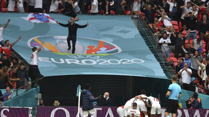 England players and fans celebrate at the end of the Euro 2020 soccer championship round of 16 match between England and Germany at Wembley Stadium in England, Tuesday June 29, 2021. (Justin Tallis, Pool Photo via AP)