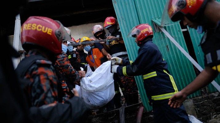 Firefighters work to douse a fire at a food and beverage factory in Rupganj, outside Dhaka, Bangladesh, Friday, July 9, 2021. At least 52 people died in a huge blaze that engulfed a food and beverage factory outside Bangladesh's capital, fire officials said Friday, in the latest industrial disaster to hit the South Asian nation. (AP Photo/Mahmud Hossain Opu)