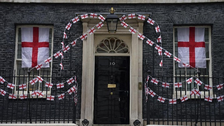 A view of 10 Downing Street, the official residence of Britain's Prime Minister Boris Johnson, decorated with England flag bunting, ahead of the Euro 2020 soccer championship final match between England and Italy   on Sunday, in London, Friday, July 9, 2021. (Aaron Chown/PA via AP)