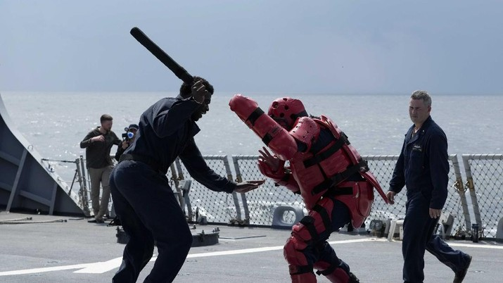 US Navy sailor of destroyer USS Ross Davonne Chestnut from Phoenix, Arizona, left, practices hand-to-hand combat during Sea Breeze 2021 maneuvers,  in the Black Sea, Wednesday, July 7, 2021. Ukraine and NATO have conducted Black Sea drills involving dozens of warships in a show of strong defense ties amid the heightened tensions in the wake of last month's incident with a British destroyer off Crimea. (AP Photo/Efrem Lukatsky)