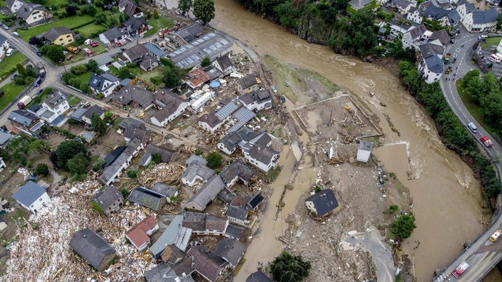 Destroyed houses are seen close to the Ahr river in Schuld, Germany, Thursday, July 15, 2021. Due to heavy rain falls the Ahr river dramatically went over the banks the evening before. People have died and dozens of people are missing in Germany after heavy flooding turned streams and streets into raging torrents, sweeping away cars and causing some buildings to collapse. (AP Photo/Michael Probst)