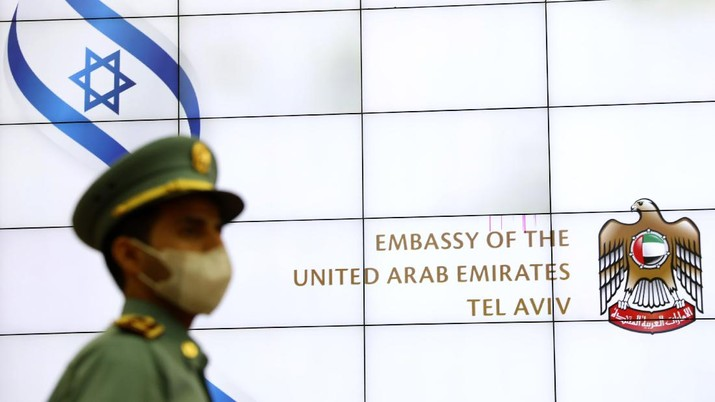 A United Arab Emirates guard stands during the opening ceremony for the new UAE embassy, in Tel Aviv, Israel, Wednesday, July 14, 2021. The UAE formally opened its embassy less than a year after the two countries announced they would establish open relations. (AP Photo/Ariel Schalit)
