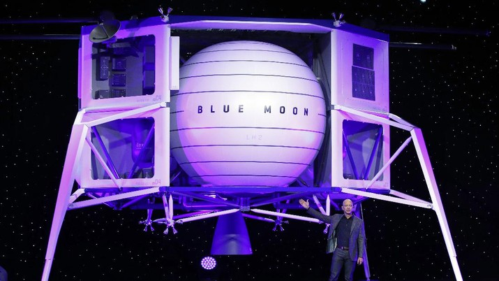 FILE - In this Thursday, May 9, 2019 file phto, Jeff Bezos speaks in front of a model of Blue Origin's Blue Moon lunar lander in Washington. In 2020, NASA Administrator Jim Bridenstine said space is currently a $400 billion market, including satellites. Opening up spaceflight to paying customers, he said, could expand the market to $1 trillion. (AP Photo/Patrick Semansky)