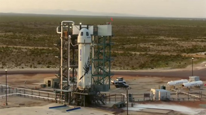 This photo provided by Blue Origin, Blue Origin's New Shepard rocket sits on a spaceport launch pad near Van Horn, Texas, Tuesday, July 20, 2021. The rocket that is scheduled to launch later this morning will carry passengers Jeff Bezos, founder of Amazon and space tourism company Blue Origin, his brother Mark Bezos, Oliver Daemen and Wally Funk. (Blue Origin via AP)