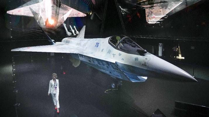 A prototype of Russia's prospective fighter jet is displayed at the MAKS-2021 International Aviation and Space Salon in Zhukovsky outside Zhukovsky, Russia, Tuesday, July 20, 2021. Russia has presented a prototype of a new fighter jet that features stealth capabilities and other advanced characteristics and will be offered to foreign customers. Russian President Vladimir Putin inspected the new warplane displayed at the MAKS-2021 International Aviation and Space Salon. (AP Photo/Alexander Zemlianichenko, Pool)