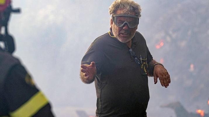 Kebakaran dipedesaan di Cuglieri, Sardinia, Italia. (AP/Alessandro Tocco)