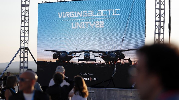 Special guests chat as they wait for Virgin Galactic founder Richard Branson's launch to space aboard his own rocket ship near Truth or Consequences, New Mexico, Sunday, July 11, 2021. (AP Photo/Andres Leighton)
