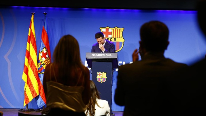 Lionel Messi is applauded during a press conference at the Camp Nou stadium in Barcelona, Spain, Sunday, Aug. 8, 2021. FC Barcelona had previously announced the negotiations with Lionel Messi had ended and that Messi would be leaving the club. (AP Photo/Joan Monfort)
