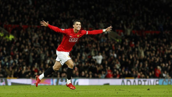 Manchester United's Cristiano Ronaldo celebrates after scoring his second goal against Bolton during their English Premier League soccer match at Old Trafford Stadium, Manchester, England, Wednesday March 19, 2008. (AP Photo/Jon Super)   **NO INTERNET/MOBILE USAGE WITHOUT FOOTBALL ASSOCIATION PREMIER LEAGUE(FAPL)LICENCE. EMAIL info@football-dataco.com FOR DETAILS. **
